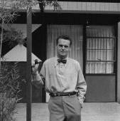 American designer Charles Eames poses in front of his home Santa Monica California 1950