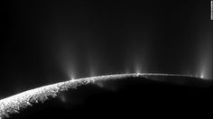 Plumes of water ice and vapor shoot up from the surface of Saturn's moon Enceladus in this two-image mosaic taken by Cassini in November 2009. Analysis by NASA scientists indicated that water can reach the Saturnian moon's surface.