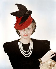 Always match your shoes to your purse, and your dead bird to your blouse.  Bird on hat. Lucille Ball, 1940s.