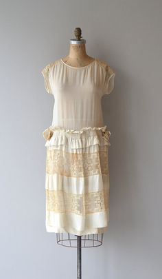 Antique 1920s cream silk wedding dress with filet lace shoulders, drop smocked waist and paneled skirt with filet lace inserts. --- M E A S U R E M E N T S ---  fits like: medium bust: 34-36 waist: up to 38 hip: up to 48 length: 40 brand/maker: n/a condition: excellent  ★ layaway is available for this item  to ensure a good fit, please read the sizing guide: http://www.etsy.com/shop/DearGolden/policy  ✩ more vintage dresses ✩ http://www.etsy.com/shop/DearGolden?section_id=5986725  ✩ visit…