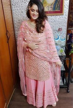 How stunning does she look in our customized mirror and sequins sharara with shirt💖💖💖…outfit and jewellery for her pre-wedding celebration😘😘😘👌🏻👌🏻👌🏻👌🏻Image may contain: 1 person, standing Punjabi Suits Party Wear, Party Wear Indian Dresses, Designer Party Wear Dresses, Indian Fashion Dresses, Indian Gowns Dresses, Dress Indian Style, Pakistani Bridal Dresses, Pakistani Dress Design, Indian Wedding Outfits