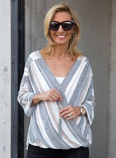 24dbb1ebf46fcc Stripe Crossover Dolman Sleeve Blouse is a beautiful blouse that you can  wear to work or a fun day or night outing and is now available in our shop
