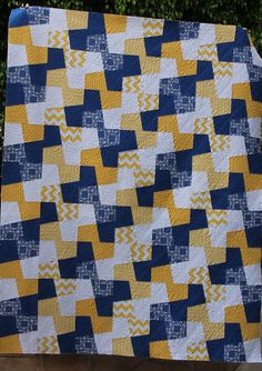 like the way a simple four piece block, when put together, creates a larger design 7-8 fabrics. 2 blocks. replace blue with read, or do on bloc with blue, on with red.