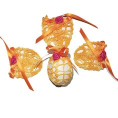 Set of 4 Hand Crocheted Crochet Easter Egg Covers. Hand crocheted with an ombrè cotton thread with satin ribbon and a flower decoration. Used for putting hard boiled eggs or polystyrene eggs inside of it. It is a great gift idea.  Package includes: 4 Crocheted Easter Egg Covers 1 Storage Bag Easter Crochet, Hand Crochet, Hard Boiled, Boiled Eggs, Cotton Thread, Flower Decorations, Bag Storage, Easter Eggs, Great Gifts