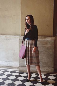 Simplify your outfit for the weekend with a long striped skirt and a black long sleeve.