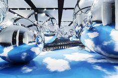 Bureau Betak >>> used spherical mirror globes to distort Christian Dior's runway at the Place Vauban, Paris.