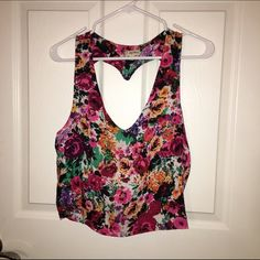 Floral crop top. Lily White originally purchased from Von Maur. Floral print. Crop top. V-neck. Heart shaped open back. Large. Like new! Lily White Tops Crop Tops