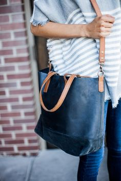 The Abera Crossbody Tote can be worn over the shoulder, or across your body, and is the ideal size to function as your work bag or as your everyday purse. It features an interior pocket and a magnetic closure, and is available in 4 color options.