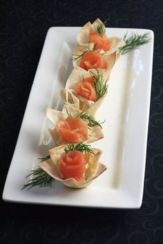 Smoked salmon in wonton cups - something to do with that salmon in the freezer?  24 square wonton skins 1/2 cup mascarpone cheese, room temperature 1 tbsp plus 1 tsp horseradish 2 tsp finely chopped fresh dill 1/8 tsp kosher salt 1/8 tsp freshly ground black pepper 6 oz. smoked salmon, cut into 24 equal pieces Fresh dill springs