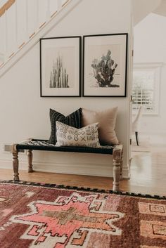 Modern Southwestern Decor In An Entryway Featuring A Large Area Rug And Framed Cactus Prints