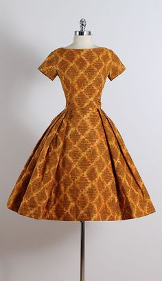 ➳ vintage 1950s dress * heavy golden orange cotton * pellon lining * abstract pattern * metal back zipper condition | good - slight fading
