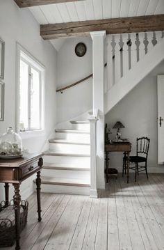 hall/stairs: pale floors + rustic beams