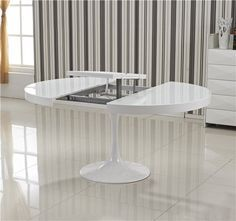 Table ronde extensible TULIPE blanche                                                                                                                                                                                 Plus