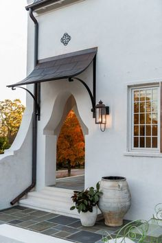 black metal awning on arch door of Beautifully Artistic Front Door Canopy Front Door Awning, Front Door Canopy, Door Overhang, Porch Awning, Metal Awning, Awning Canopy, Patio Roof, Metal Roof, House Awnings