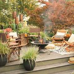 Trees and shrubs add privacy to this backyard getaway. See more deck landscaping ideas: http://www.bhg.com/gardening/landscaping-projects/landscape-basics/deck-landscaping-ideas/?socsrc=bhgpin081612animalprintspatio