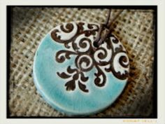 ($24.00) Pottery Jewelry by Compelled Designs. Each piece has a Bible verse engraved on the back. Proceeds help fund an adoption from Uganda!