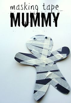 Very cute and simple Halloween craft with masking tape, black construction paper, and googly eyes!