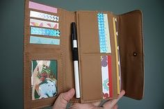 diy: busy wallet -- thrifted wallet filled with photos and scraps of paper to keep a toddler busy on an airplane. oooh-pretty-colors1
