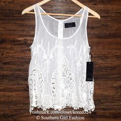 DOLCE VITA Top Embroidered Fionie Silk Eyelet Tank Size Large. New With Tags. $143 Retail + Tax.   Gorgeous white semi sheer voile tank top featuring feminine embroidery.  Buttons fasten the back.  Unlined. 