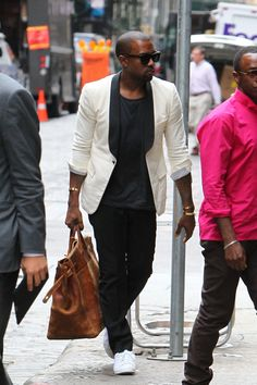 In my opinion.. Kanye is probably the perfect person to describe what we want our store image and theme to be based off of. He knows how to bring together casual and dressed up pieces to create a flawless trendy look. His outfit can also be transitioned from daytime to a night out with the addition or removal of simple pieces.