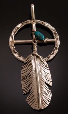 Sterling medicine wheel and feather pendant ~ Ben Begay