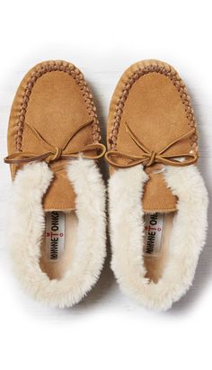 AEO Women's Minnetonka Chrissy Boot from American Eagle Outfitters. Saved to Fall/Winter Sock Shoes, Cute Shoes, Me Too Shoes, Shoe Boots, Shoes Sandals, Flats, Old Friend Slippers, Clearance Shoes, Moccasins