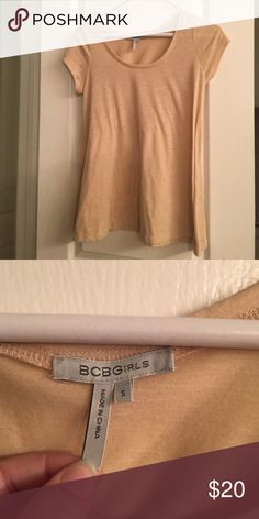 BCBG comfy tee Cute comfy tee. Runs big. Great condition. Sides are a little longer than front BCBGirls Tops Tees - Short Sleeve