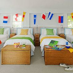Here, the walls are light and bright with pops of citrus and a string of nautical flags from West Marine. Coastalliving.com