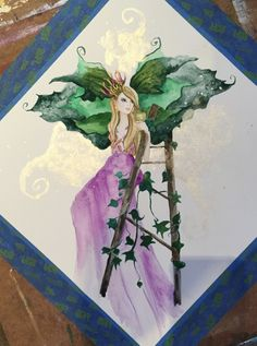 33cm X 33cm original watercolour painting of a beautiful fairy sitting on a ladder in the sky. She wears a purple dress and has green leafy wings, and enjoys a glass of white #wine.  #fairy #art #fantasy #wings #ladder #sky #purple #green #fairydust #painting #artist #deenoney