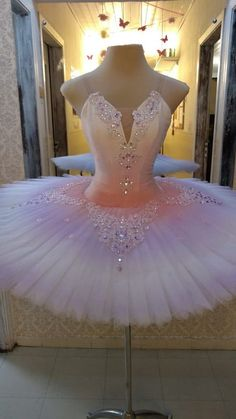 Usually tutus takes us about two weeks to be done ,this one we made it all in white and i painted it with two color (light purple and pink ) our tutus are created with hight quality of materials . We do customize orders ,contact us if you are interested to get this tutu ,also we will need your