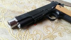 Socom gear 1911 Vickers with punisher compensator. No custom paintjob though..