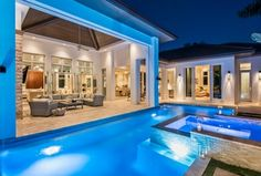 Contemporary Swimming Pool with exterior tile floors, Pool with hot tub, exterior stone floors