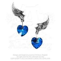 "El Corazon Earrings - ULFE15 ""El Corazon"" hangs from pewter embossed wings. The blue heart Swarovski crystal droppers, hang from delicately, detailed pewter wings."