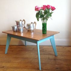 Vintage oak coffee table with splayed legs, hand stripped and finished with the clear wax, the legs painted in satin paint in Teal colour for a clean contemporary look. 84cm wide, 51cm deep and 41 | £95 | Recycled by Jessica