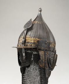 Helmet, mid-16th century; Ottoman period Turkish Steel, damascened with gold  This helmet was forged from watered steel and decorated in gold with arabesques and Qur'anic inscriptions. It is similar to a helmet (Kunsthistorisches Museum, Vienna) made about 1560 for a grand vizier of the Ottoman sultan Süleyman the Magnificent (r. 1520–66). Both helmets were presumably made in one of the imperial workshops in Istanbul.