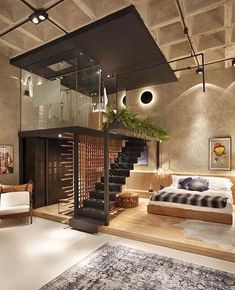 The design of the ceiling emphasizes the space in the room that's smaller but it appears bigger