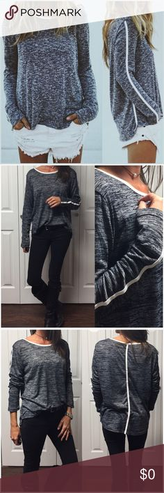 """Black & Charcoal Flecked Pullover Black and charcoal flecked, long sleeve pullover top.  Trimmed in white detail.  65% Rayon 35% Polyester Slight hi/low style.  Also available in tan/white flecked. (See separate listing)  Small:       Bust: 38"""" Length: 22"""" Medium:   Bust: 40"""" Length: 22"""" Large:       Bust: 42"""" Length: 22""""  ✨Length in back runs 2 to 3 inches longer than front length measurements listed above.✨  ❗️Price is firm unless bundled❗️            #RF62898 Tops"""