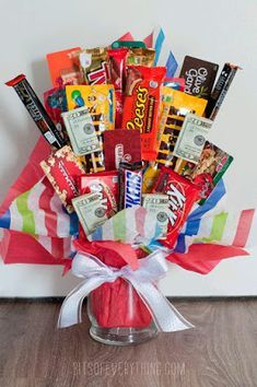 My cute neighbors recently got married. I collected a good amount of donations from all the other neighbors to give the happy couple a gift. What I decided to give them was a candy bar bouquet filled with other good things like gift cards and cash. It wa Candy Bar Gifts, Candy Gift Baskets, Raffle Baskets, Gift Baskets For Men, Gift Card Bouquet, Money Bouquet, Homemade Gifts, Diy Gifts, Candy Bar Bouquet