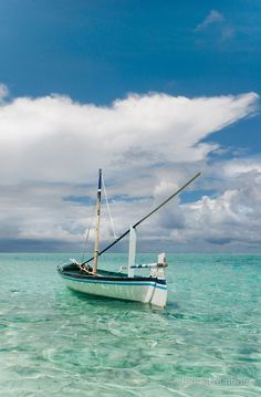 Maldivian Boat Dhoni on the Peaceful Water of the Blue Lagoon