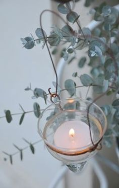 Candle in hanging glass.