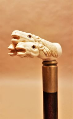 Horse heads carved bone cane / walking stick