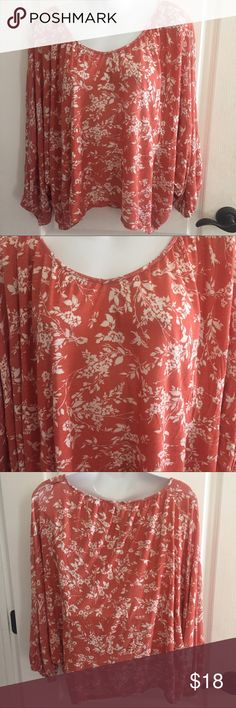 """LC Lauren Conrad medium print top 3/4 sleeves LC Lauren Conrad print top. Short in length and fuller across the bodice. 3/4 full sleeves with elastic at the bottom. Fabric tag has been removed but feels like a Rayon blend. Length in back approx 22"""" Very pretty from a smoke free home. LC Lauren Conrad Tops"""