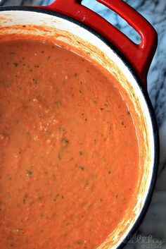 Creamy Tomato Basil Soup _ A healthy homemade Creamy Tomato Basil Soup perfect for dunking those crunchy grill cheese in! Ya know what, you don't need all that fatty stuff to get a tasty Creamy Tomato Basil Soup. All you need are tomatoes, basil, & a little cream cheese for the creaminess factor & viola restaurant quality Tomato Basil Soup. This is one of my all time favorite soup recipes & even better with a crunchy grilled cheese sandwich to dunk in the soup. YUM! Hope you enjoy!