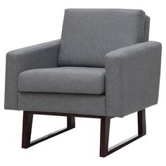 Unwind with your book club novel or savor a freshly-made martini in this chic arm chair, showcasing a midcentury-inspired silhouette with handsome grey uphol...