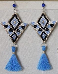 Excited to share the latest addition to my #etsy shop: Brick Stitch Earrings with Tassel charm-silver, navy blue, and light blue miyuki delica seed beads, Swarovski bicone Sapphire bead earwire #jewelry #earrings #blue #boho #earwire #yes #girls #silver #triangle #brickstitch #tasselearrings #tribaldesign #ladderstitch #womensfashion #spring2018 #swarovskicrystal #sapphire #victoriasdesignsus