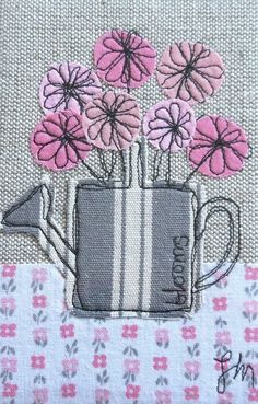 Watering can with flowers - framed freestyle machine embroidery - Joe Melrose Designs .