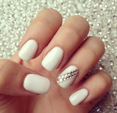 White nails, with rhinestone accent