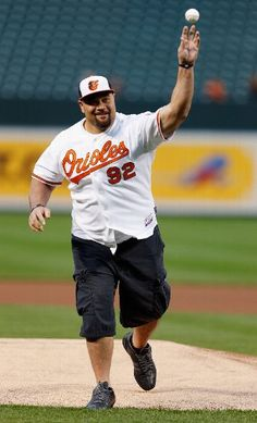 BALTIMORE, MD - MAY 07: Football player Haloti Ngata of the Baltimore Ravens throws out the ceremional first pitch before the start of the Baltimore Orioles and Kansas City Royals game at Oriole Park at Camden Yards on May 7, 2013 in Baltimore, Maryland.  (Photo by Rob Carr/Getty Images)