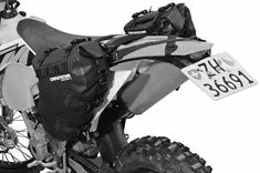 These saddle bags attach to the number plates of any enduro or ADV bike and are shaped not to interfere with the typical off road riding position. Bike Saddle Bags, Shoes For Less, Motorcycle Saddlebags, Mtb Shoes, Airsoft Helmet, Mountain Bike Shoes, Cool Bike Accessories, Touring Bike, Riding Gear