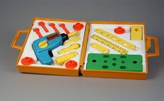 ".Fischer Price Tool Kit. I think I had it. I remember the box and the drill. It was so I could ""help"" dad fix things."